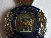 BADGE - Australia - Qld - Queensland Government Security Empowered Officer cap badge (obsolete)