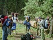 A team of Varsity Scouts getting ready to head out on a backpacking trip.