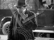 Peter Lorre as Hans Beckert, gazing into a shop window. Lang uses glass and reflections throughout the film for expressive purposes.