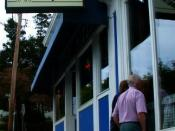 Tourists look into the famous pizza parlor in Mystic.