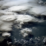 This photograph, acquired in February 1984 by an astronaut aboard a space shuttle, shows a series of mature thunderstorms located near the Parana River in southern Brazil. With abundant warm temperatures and moisture-laden air in this part of Brazil, larg