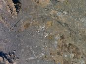 A satellite picture of the El Paso—Ciudad Juárez international metropolitan region on the Mexico-U.S. border. Ciudad Juárez, Chihuahua, Mexico (lower area) El Paso, Texas, U.S. (upper area).