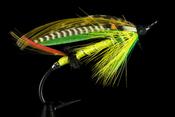 English: Green Highlander salmon fly. The hook length in this example is 4.5cm. Français : Mouche pour la pêche au saumon. L'hameçon fait 4,5 cm.