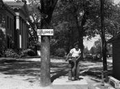 An African-American child at a segregated drinking fountain on a courthouse lawn, North Carolina, 1938.
