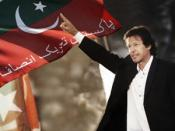 English: Picture of imran khan infront of the flag of Pakistan Tehreek-e-Insaf. It has been taken by the Administration of www.insaf.pk, who have allowed to use it.