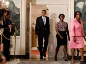 President Barack Obama walks to stage to discuss student loans in the Diplomatic Reception Room.