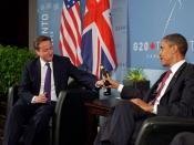 English: US President Barack Obama and British Prime Minister David Cameron trade bottles of beer to settle a bet they made on the U.S. vs. England World Cup Soccer game (which ended in a tie), during a bilateral meeting at the G20 Summit in Toronto, Cana