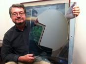 Dan Hutcheson CEO of VLSI Research holds a 450mm silicon wafer