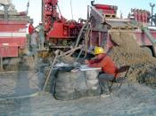 English: A picture of a mud log in process. Mud logging is the process of recording the lithology a rotary drill penetrates, typically used in oil well drilling.