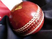 Standard cricket ball on a cricket shirt.