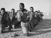English: Maori Battalion survivors of action in Greece, performing a haka in Helwan, Egypt for the King of Greece. From left to right, the four men in the foreground are John Manuel, Maaka White, Te Kooti Reihana, and Rangi Henderson. A cropped version of