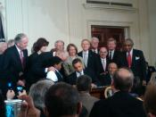 English: Barack Obama signing the Patient Protection and Affordable Care Act at the White House
