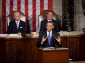 English: President Barack Obama discusses his jobs plan, the American Jobs Act, in a speech delivered to a joint session of the 112th United States Congress on September 8, 2011. Vice President Joe Biden and House Speaker John Boehner are seated behind th