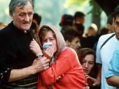 English: A family mourns during a funeral at the Lion's cemetery in Sarajevo, 1992.
