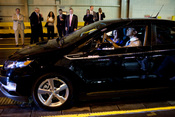 President Barack Obama, with Assembly Manager Teri Quigley, drives a new Chevy Volt, during his tour of the General Motors Auto Plant in Hamtramck, Mich., July 30, 2010. (Official White House Photo by Pete Souza)