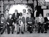 Photograph taken post Kenyan Independence, showing the first President Jomo Kenyatta sitting next Zafrud Deen, President of the Muslim League (also an ex-MP of Colonial Kenya). The photograph also shows current President Mwai Kibaki in his early years.