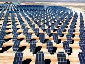 English: On 140 acres of unused land on Nellis Air Force Base, Nev., 70,000 solar panels are part of a solar photovoltaic array that will generate 15 megawatts of solar power for the base.
