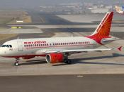 English: Air India (Erstwhile Indian Airlines) A319 taxies at Mumbai airport for a departure.