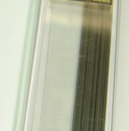 Pencil lead for a mechanical pencil. The mass of the package is 7.19 grams while the mass of all the graphite stored within it totals 1.23 grams.