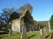 English: Kilmorie Chapel The historical burial place of the chiefs of the Clan Lachlan. The roofless medieval chapel, which was in imminent danger of collapse, has been sensitively repaired, with no attempt to 'restore' the building. http://www.traditiona