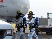 English: Lehigh Valley International Airport Trapnsportation Emergency Preparedness Program Exercise - Responders Extinguish Belt Loader Fire at the Exercise Accident Scene.