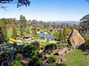 This view from the Symbolic Mountain in the gardens in Cowra, Australia shows many of the typical elements of a Japanese garden.