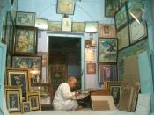 Sitting amidst his painting, he creates magic with his brushes painting Lord Krishna woven in golden threads and brilliant hues. His small shop, also his studio and home in temple town of Nathdwara, holy place revered in glory of ShriNathji, Krishna is be