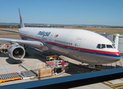 English: Malaysia Airlines Boeing 777 flight MH138 docked at Adelaide Airport awaiting departure