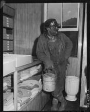 Miner who is shopping with his family in the subsidiary company store. This store carries a large selection of good... - NARA - 540855