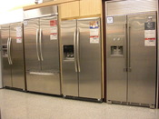 English: This is a picture of refrigerators, some of which go up to thousands of dollars. The function of a refrigerator can be performed for far cheaper.