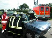 Accident: German firefighter try to rescue the person, who is in the car