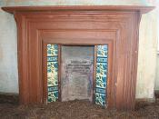 English: Fireplace at Glenbeg The door was unlocked, the windows glassless, and the whole house full of pigeon droppings. This bonny fireplace adorns what would have been the living room or parlour.