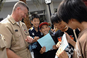 English: ATSUGI, Japan (July 7, 2009) Master Chief Petty Officer of the Navy (MCPON) Rick West meets and talks with Japanese sixth grade elementary school students at Naval Air Facility Atsugi, Japan during his visit to the base. The students come to base