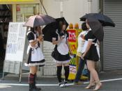 English: Teenage girls dressed as maids handing out promotional flyers for a Maid Cafe in Den-Den Town, Osaka, Japan