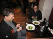 Dining and checking the smart phones at a sidewalk table, Green Goddess, New Orleans.