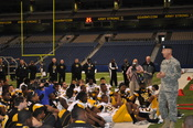 Col.(P) Victor Petrenko, deputy commanding officer, U.S. Army Acessions Command, talks to All-American Bowl players about valuable Army values they should live by.
