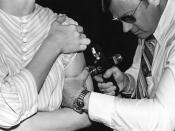 This 1976 photograph showed an adult receiving a vaccination with a jet injector during the swine flu nationwide vaccination campaign, which began October 1, 1976.