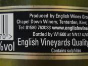 English: Back label of an English wine indicating its official quality designation, English Vineyards Quality Wine psr (