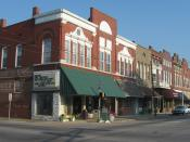 English: Buildings on Third Street facing Courthouse Square in Boonville, , . This block is part of the , a historic district that is listed on the .