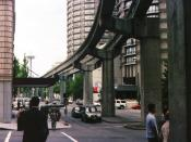 The monorail tracks with the Space Needle visible in the distance