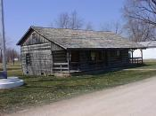 English: Historic log homestead in Novinger Missouri USA. Other buildings subsequently added.