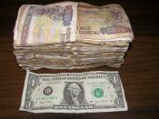 English: The Guinea Franc was about 5000 Franc to one dollar. Conakry Guinea