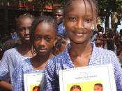 Schoolgirls with books donated by USAID in Conakry, Guinea