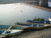 Boats floating besides the Ravi River in Lahore.