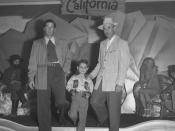 English: Title: Don Phillips, John Wayne Wright and Paul Bradley model new fall fashions for men, Calif., 1948 Published caption:AUTUMN FORECAST -- From left, Don Phillips, John Wayne Wright and Paul Bradley model new fashions which men and boys are expec