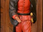 Personnage de la commedia dell'arte. Petite statue en plâtre peint (environ 100 cm) provenant du Théâtre Séraphin installé au Palais-Royal à la fin du XVIIIe siècle et conservée au musée Carnavalet à Paris (série de quatre pièces : Arlequin – Pantalone –