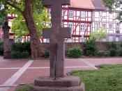 Patriarchal cross at the entrance to monastery borough in Bad Hersfeld