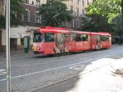 English: A Mannheim tram in Helsinki, Finland. Line 6, Hietalahti-Arabianranta. The tram is painted pink and advertising L'Oreal products.