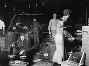 English: Original description: Day scene. Wheaton Glass Works. Boy is Howard Lee. His mother showed me the family record in Bible which gave birth July 15, 1894. 15 years old now, but has been in glass works two years and some nights. Started at 13 years