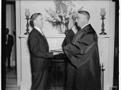 English: Fred M. Vinson is sworn in as an Associate Justice of the District of Columbia Court of Appeals by court clerk Joseph W. Stewart